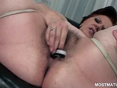 Kinky mature shoving panties and fingers in her hairy cunt