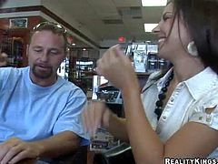 Busty and handsome milf in white shirt and black skirt gets seduced by a hunky charming dude in a cigarette shop and gets caught on camera with him