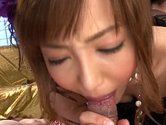 Decent looking Japanese wench is going wild and dirty in a steamy threesome session. She sucks two dicks in a row sitting on her knees.
