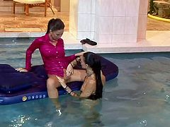 Sexy lezzies are bathing in water in their clothes. Tracing their hands over each other's bodies they get horny. So, they start spicy lesbian sex right in the pool.