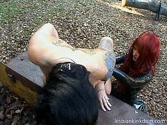 Incredibly hot and rapacious redhead in long leather coat makes submissive busy brunette bends over. Tattooed black head has to stretch her legs, while bitchie red haired lesbo jam her boobs, rub clit and smacks ass rough. These bitche gonna reach orgasm outdoors. Just press and enjoy them in Pack of Porn sex clip.