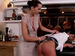 Pitiless mistress punishes unexperienced maid by bending her over the stove in order to slap her juicy ass with pressure in sizzling hot DDF Network sex clip.