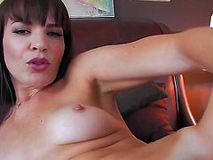 Dana DeArmond gives a closeup of her wet hole as she masturbates