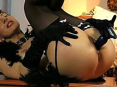 Brunette Nina Young finds herself horny and takes sex toy in her snatch with desire