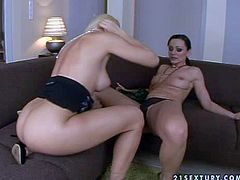 Attractive blonde bombshell Sandy with tight ass and cheep tattoo above ankle licks her black haired girlfriend in black undies and stuffs her pussy with vine bottle to loud orgasm