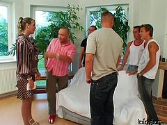 In order to try a new couch, group of aroused young fuckers hook up with a sextractive blond milf. They force her ride one of them in reverse cowgirl style while giving blowjob to the rest of the guys in sizzling hot gangbang sex video by Tainster.