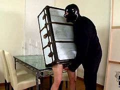 Geeky-looking dude in Fantomas costume pounds hard a rapacious slut enchained in footlocker through the holes in fun sex video by DDF Network.