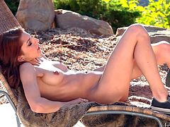 Lexi Bloom is a young sweet babe with natural tits that spends time finger fucking her snatch in the sun. Watch attractive babe make herself orgasm in the open air in solo scene.