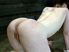 Tied up brunette chick toys her vagina with a vibrator and then gets tied up. Later on she gets her pussy gaped and toyed deep.