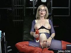 Horny blonde mature with big natural tits enjoys large toy stimulating her vag