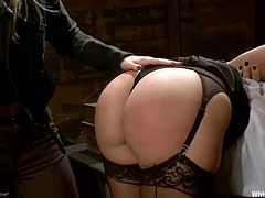 Ashley Fires is having fun with lewd blonde Roxanne Hall indoors. Roxanne tortures and beats Ashley and then fucks her cunt deep and hard with a strap on.