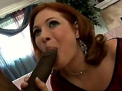 Mature Ginger Blaze with big jugs spends time fingering her beaver