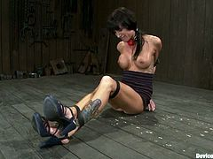 This hot brunette chick is no other than Gia Dimarco and she's gonna get her pussy fucked hard and deep in this bondage sex video.