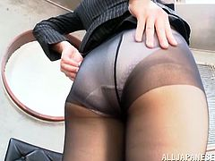 Pretty Japanese chick Yuri Sato wearing pantyhose shows her feet to her man and lets him rub his prick against her toes till it explodes with cum.