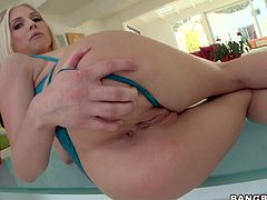 Turned on pale blonde bombshell Christie Stevens with tattoo on lower back and big juicy knockers in blue undies stuffs her firm ass and shaved cunny with pink vibrator