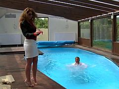 She is sizzling redhead bitch with hot and sexy body. She bathes in a pool with handsome dude. Then she gets her cunt eaten dry on a sunbed.