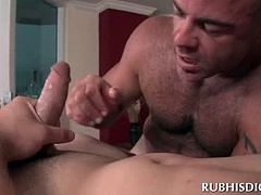 Tattooed nasty gay masseur having his butt nailed hardcore from behind