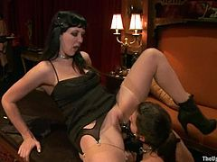 Two brunette girls make hot bondage show. They toy each others pussies with a strap-on fixed to their heads.