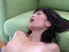 Saki Aoyama lays with her head near the floor and her feet in the air on top of the couch. This is the perfect position for her to have a gigantic dick shoved inside her pretty little mouth. Her man licks her wet cunt and rubs the tip of his cock on her pussy lips. She's so moist.