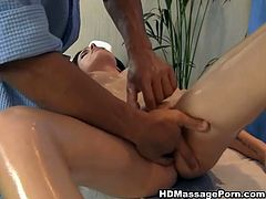 After amazing oily massage black haired beauty gets extremely aroused. She spreads her legs apart so masseur could finger fuck her hungry cunt.