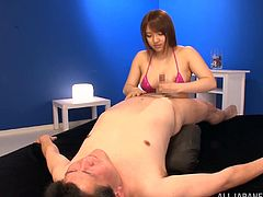 Kinky Japanese girl wearing fishnets is having fun with some guy indoors. She pleases him with a blowjob and a titjob and then shows her footjob and grinding skills.