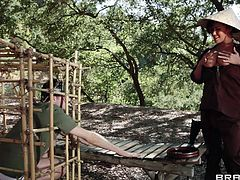 London Keyes is a Viet Cong soldier in the Vietnam war and James Deen is an American soldier who she locks up. She lets him out of his Cage so she can take advantage of him sexually. He grabs her big boobs and sucks her tits then she gets on all fours and sucks his cock.