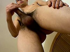 Slutty dark-haired dude with nice face is masturbating