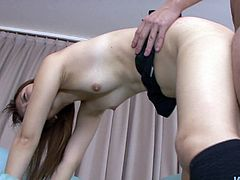This sex-starved slut from Japan is an experienced cock sucker. She gets down on her knees to give her lover the best blowjob of his life. Then she bends over to let him drill her hairy pussy from behind. Later she climbs on top of him and rides him in reverse cowgirl pose.