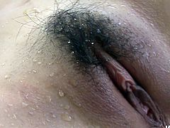 Fuckable Japanese cutie stands in doggy pose exposing her bearded vagina for a hard drill with dildo before she lies on her back to get it tickled with vibrator in steamy solo sex video by Jav HD.