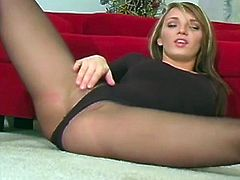Adorable gal enjoys teasing by gently undulating her ass in those sexy pantyhose