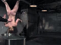 Watch this blonde babe end up completely wet in this bondage video where her master uses water to punish her.