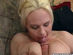 This busty, beautiful blonde loves getting wang between her juicy fat melons. She deep throats her man's cock before getting back to being tit fucked. She licks the tip of her man's cock and then he inserts it into her vagina.