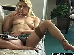 Arousing model likes smoking and posing her sexy stockings during impressive solo