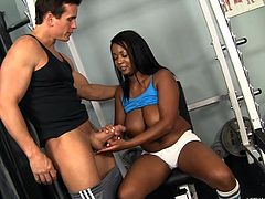 Black beauty Ghettman works out to stay in shape but her trainer has some unconventional exercises in his mind. He is anxious to fuck this ebony slut and tries his luck. Talon raises her shirt and seeing that she has no objections he goes further and gives this whore his dick. Yeah look at her sucking it now!