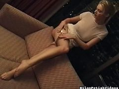 Sweet blonde teases with her feet while gently masturbating in kinky solo action