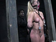 A blonde submissive sex fucking slave gets tied up and gagged so she can be fucking abused by the dominant side of the whole deal.