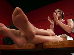 Cliff Adams is having fun with brunette milf Krissy Lynn. He licks her nice tits and fucks her doggy style and then asks the slut to favour him with a footjob.