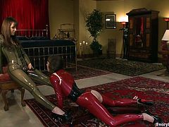 A couple of hotties in some provocative tight latex outfit each, proceed to insert fingers and hard toy's in each other's tight butt-holes.