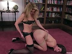 Bobbi Starr and Mistress Matisse have crazy lesbian sex in a library. Brunette chick gets tied up and then ass fucked from behind with strap-on.