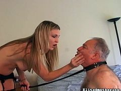 Horny blonde strokes her guy with strapon during nasty femdom porn scene
