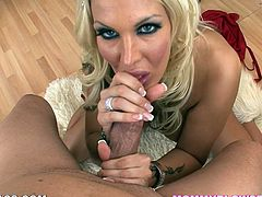 Busty blonde MILF shakes her boobs and then drops to her knees. After that she starts to suck big dick. She also gets her face covered with cum.