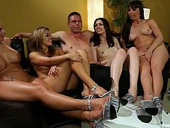It's a kinky reverse gangbang with one guy and four foot fetish babes who will tease his dick with her feet and have some hot sex too.