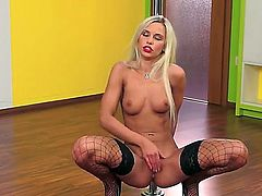 Leggy blonde babe Dido Angel stays in black fishnet stockings and black high heeled shoes. She is showing all of sweetest parts of hers before starting to finger twat.