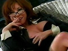Hot milf with sexy glasses smokes and poses nude, teasing like a true slut