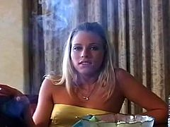 Hot gal is horny and would enjoy some naughty pleasure while smoking her cigarette