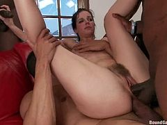 Bobbi loves big black sausages in large quantities. She blows four huge dicks in her bedroom. Then she gets tied up and pounded in both holes.