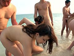 Whorish Japanese girls Hina Maeda, Kyouko Maki and Yui Nanase have fun on a beach with several horny studs. This kinky group sex video is brought to you by Jav HD.