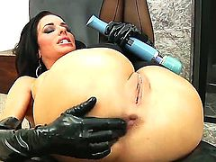 Veronica Avluv in hot black stockings is spreading her legs and getting her asshole stuffed with two giant dildos.