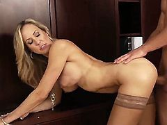 Hot and sexy blonde lady Brandi Love is sitting nude in her office chair with spread legs and having young guy Bruce Venture licking and then fucking her pussy.