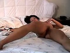 Kinky black haired Indian chick strips on can to boast of her nice boobs and flossy appetizing ass. Slutty nympho bends over the bed and rubs her wet pussy passionately to reach orgasm on her own. Just check her out in Indian Sex Lounge solo clip and be sure to jizz at once.